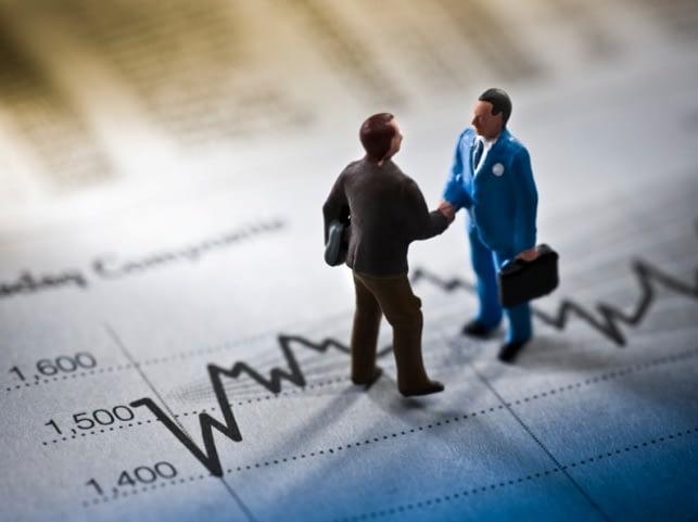 Handshake financial deal concept
